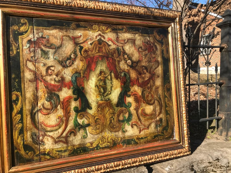 Strong Provincial feel. A centrally placed winged Fairy Holding garland stands under a canopy flanked by seraphs, garlands and scrolls , probably an Allegory of Spring .Part of a boiseries removed, framed and framed again. The inner frame late 19th