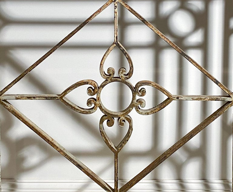 A neoclassical style painted  Wrought-iron console with slate top  Measures: Height 40 inches, width 53 inches, depth 13 inches.   Provenance:  Richard Kazarian, Providence, Rhode Island.  Property from a Private Collection, Southampton, New