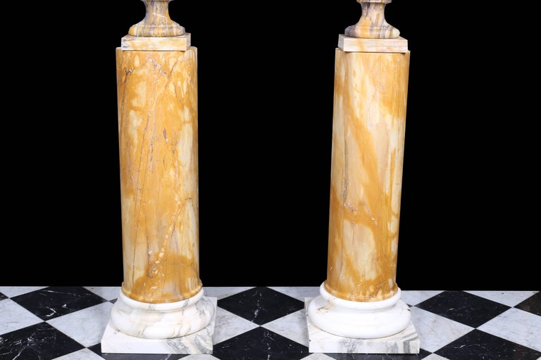 Italian Neoclassical Style Vintage Grand Pair of Marble Urns on Column Plinths For Sale