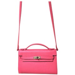 a new Pochette pink leather with shoulder strap