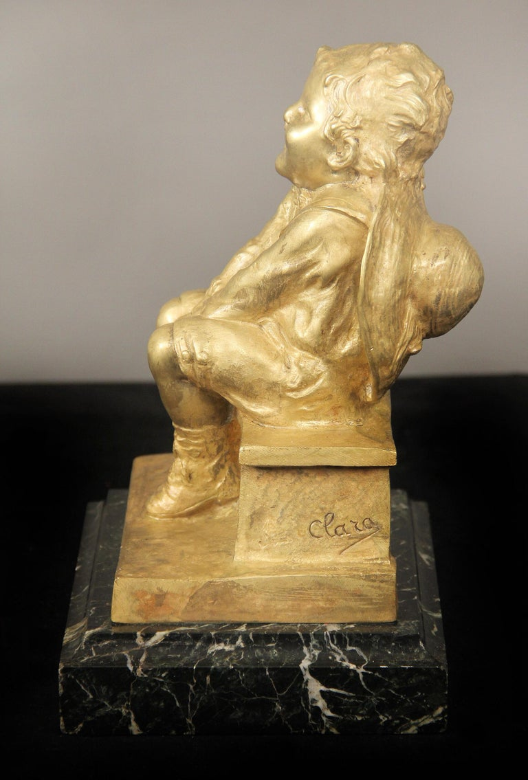 Belle Époque Nice Gilt Bronze Sculpture of a Child Seated on a Marble Base by Juan Clara For Sale