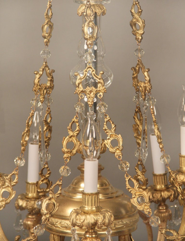 A nice late 19th century gilt bronze and crystal nine light chandelier