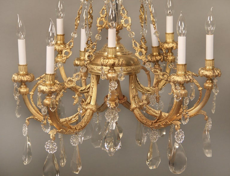 French Nice Late 19th Century Gilt Bronze and Crystal Nine Light Chandelier For Sale
