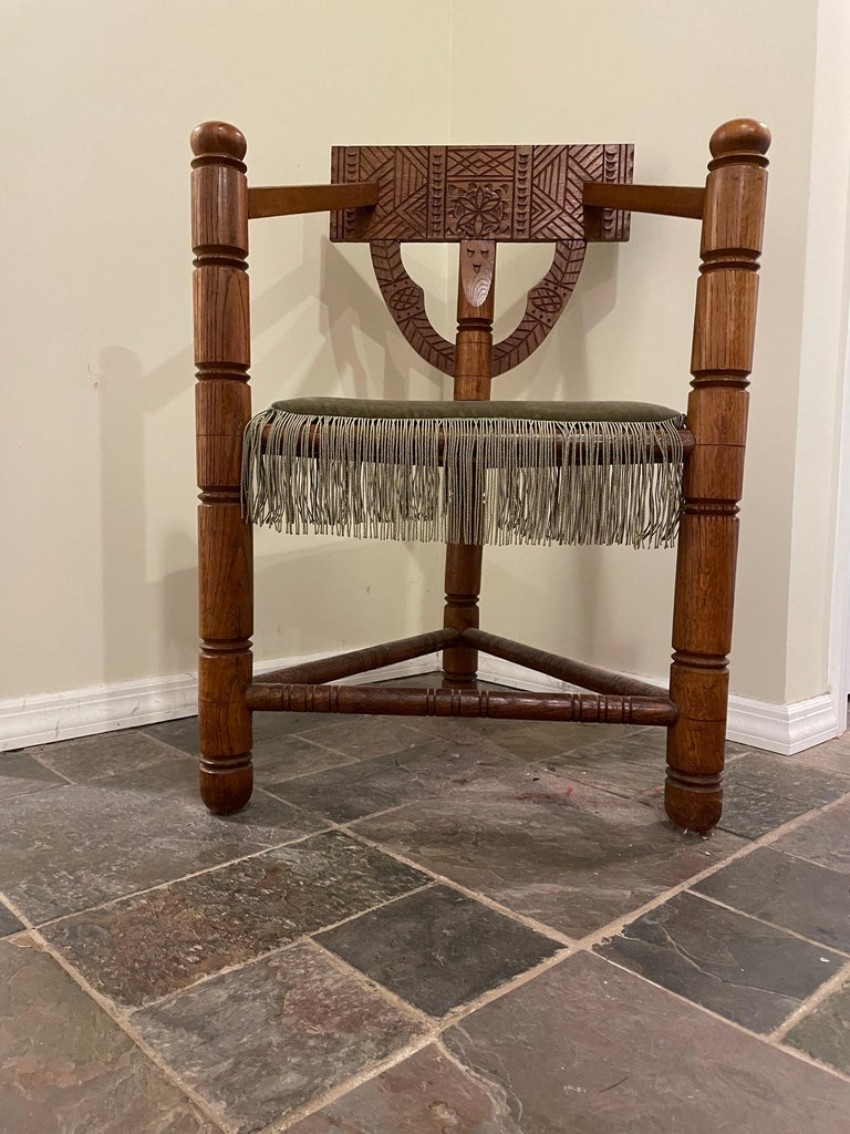 Hand crafted of solid European oak, this unique three legged chair is surprisingly strong and comfortable. This type of chair was carved with ancient