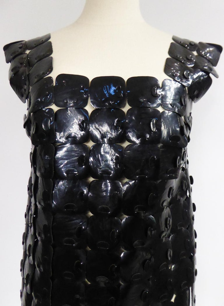 Circa 1970 France  Space Age tunic in square vinyl / black leatherette from the multi dress concept developed by Design Bory in Paris in the 1970s in the line of Paco Rabanne. Peplum effect rendered by the square neckline, the wide legs at the