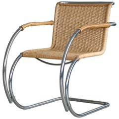 A Pair Mies van der Rohe MR20 Bauhaus Lounge Chairs in Chromed Steel and Wicker