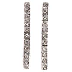 Pair of 14 Karat White Gold Row Diamond Drop Earrings