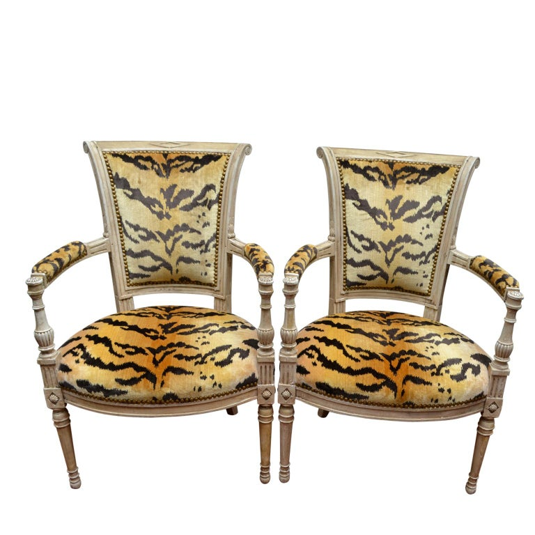 A pair of period 18th century painted Louis XVI open armchairs upholstered in modern tiger silk velvet.