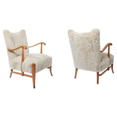 Pair of 1940s Swedish Birch Wood Armchairs Upholstered in Mohawi Sheepskin