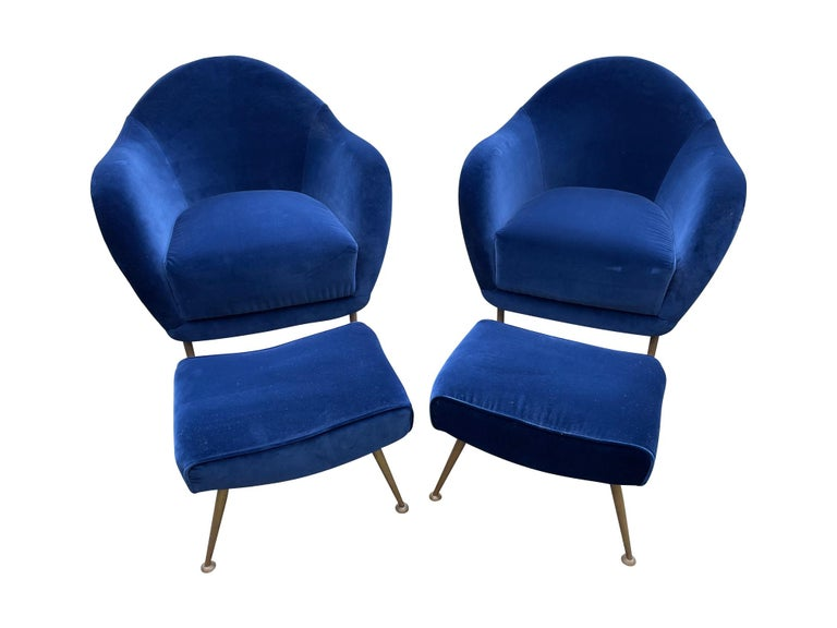 A lovely pair of 1950s Italian armchairs in the style of Guglielmo Veronesi with matching ottomans, all with original brass legs and reupholstered in Designer Guild