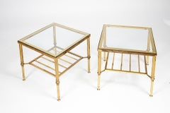 A pair of 1960's Jansen style glass and gilt metal occasional low tables