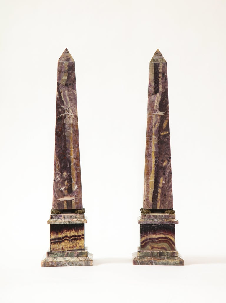 A fabulous and quite fine pair of 19th century Louis XVI style English turtle-form Ormolu Mounted Blue John (Fluorspar) Obelisks. Each obelisk is finely hand-carved with the finest quality English blue john and mounted on a square plinth. Between