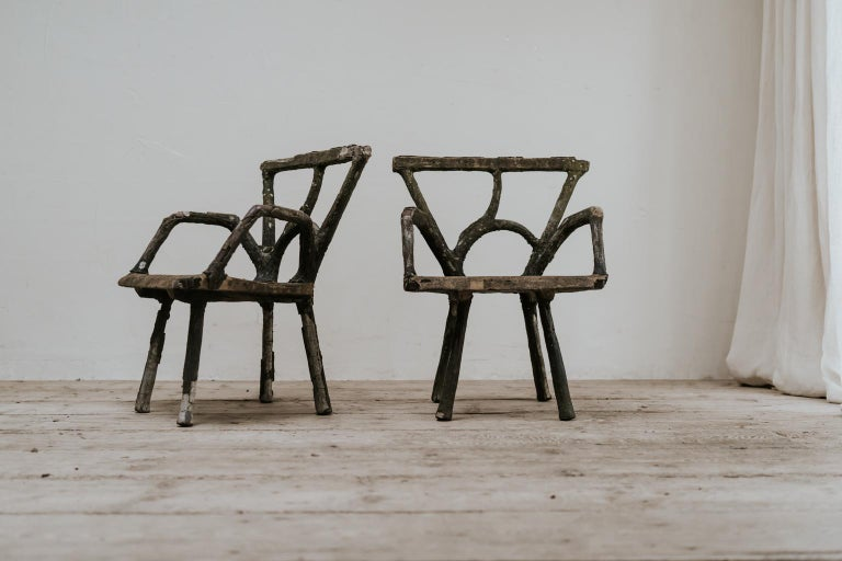 Stunning pair of beautiful weathered garden furniture, these French faux bois armchairs came from a castle garden in France, elegant and sturdy at the same time.