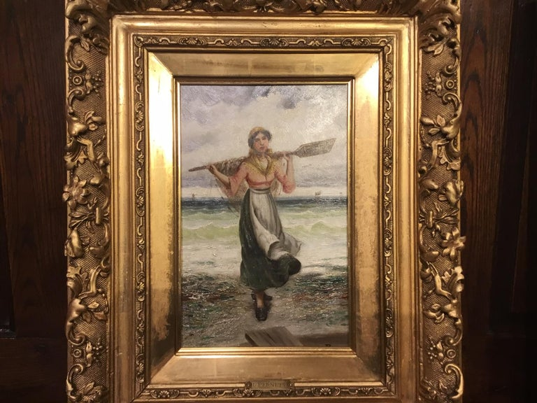 A pair of 19th century oil paintings by L. Pernett depicting a Breton fisherman and fisherwoman, housed in their original finely carved giltwood frames, titled en verso and with monogram. French circa 1890-1900