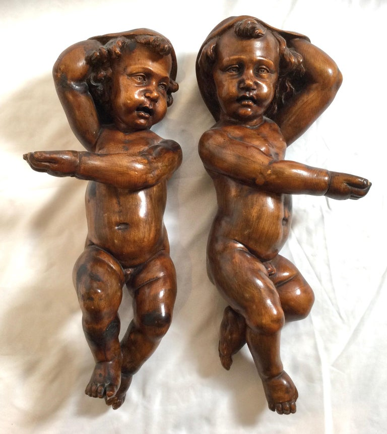 Renaissance Revival Pair of 19th Century Hand Carved Italian Walnut Cherubs For Sale