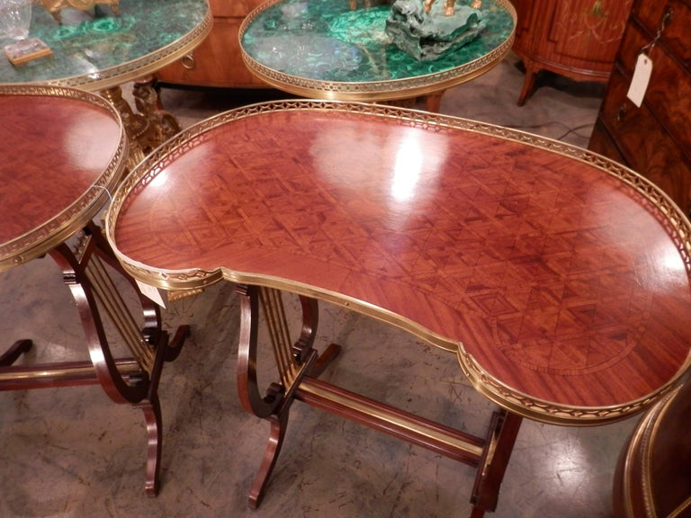 A beautiful pair of 19th century French Louis XV kidney shapes side tables with lyre shaped design by G Durand. Parquetry design tops with gilt bronze gallery and gilt bronze details. Stamped G. Durand.