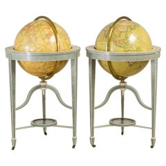 A pair of 21 inch contemporary library floor-standing globes