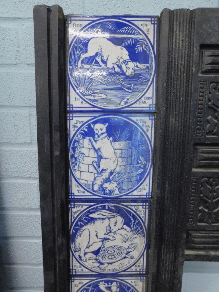 English Pair of Aesthetic Movement Cast Fire Inserts with Mintons Aesop's Fables Tiles For Sale