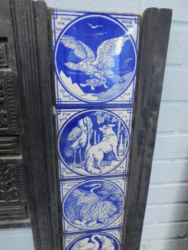 Pair of Aesthetic Movement Cast Fire Inserts with Mintons Aesop's Fables Tiles In Good Condition For Sale In London, GB
