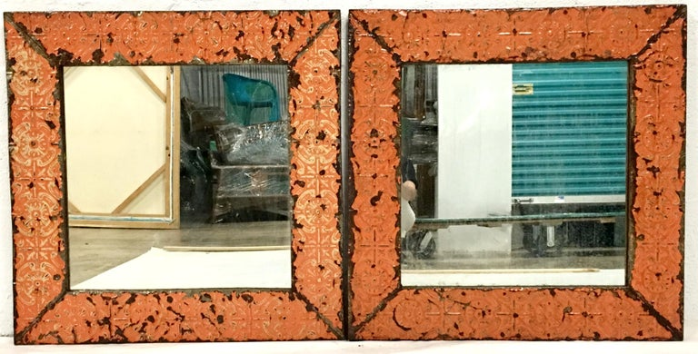 Antique Pair Of Copper New York City Ceiling Tile Mirrors. Salvaged from 19th Century New York City buildings, painted orange copper tile mounted on wood pair of of square wall mirrors Ready to hang with existing mounted hardware.