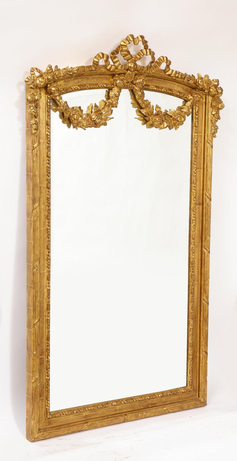 Late 19th Century Pair of Antique French Louis XVI Style Hand Carved Giltwood Mirrors For Sale
