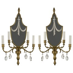 A pair of antique mirrorback four-arm sconces