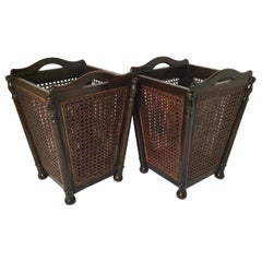A Pair of Antique Walnut and Cane Wastebaskets
