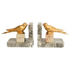 Pair of Art Deco Gilt Metal Birds and Marble Bookends