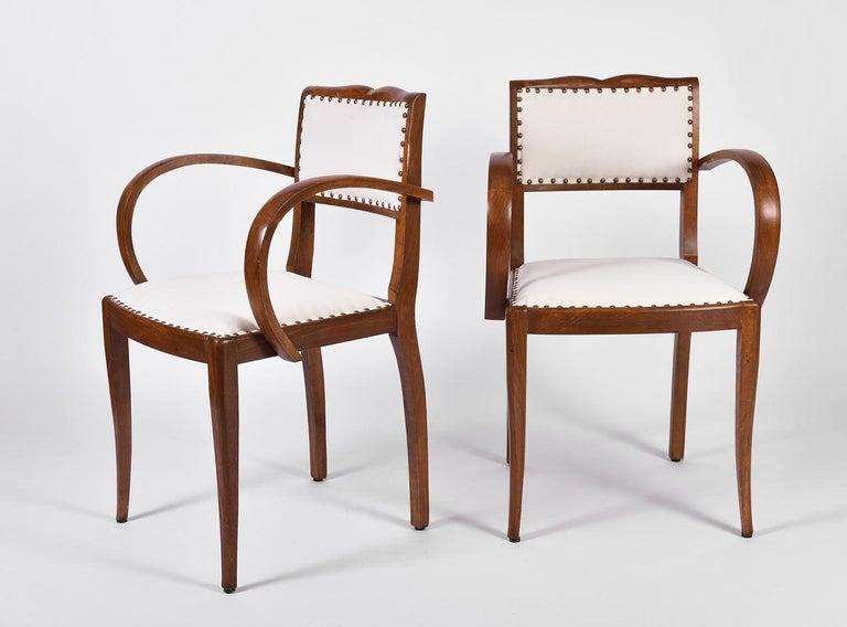 A pair of Art Deco oak chairs Upholstered in off-white velvet France, circa 1920.
