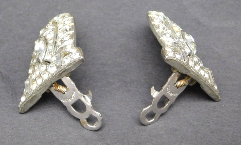 A pair of Art Deco shoe clips set with crystals. The understated elegance of the old crystals makes these clips the perfect embellishment for bridal shoes.