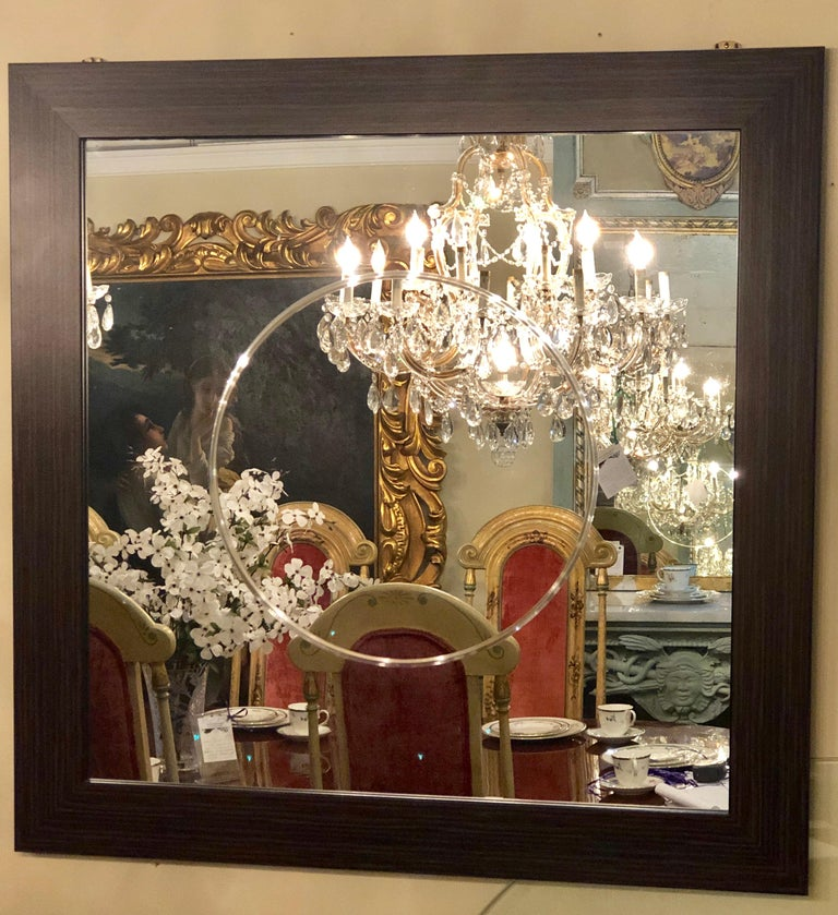 Pair of Art Deco style faux Macassar square console or wall mirrors. Purchase from a hotel in France we have one dozen of these squarish wall or console mirrors. Each having an etched circular in the center of the clear mirror set in a rosewood or