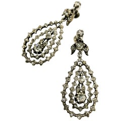 A pair of articulated multi hoop silver and paste drop earrings, French, c1900s