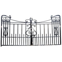 Pair of Arts & Crafts Hand Forged Iron Gates with Sweeping Top Rails