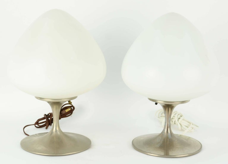 A pair of Bill Curry acorn Laurel lamps in brushed aluminum.