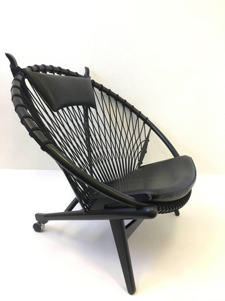 Danish Pair of Black Lacquer Oak and Learher Lounge Chairs by Hans Wegner For Sale
