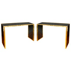 Pair of Black Lacquered and Brass Rim Consoles
