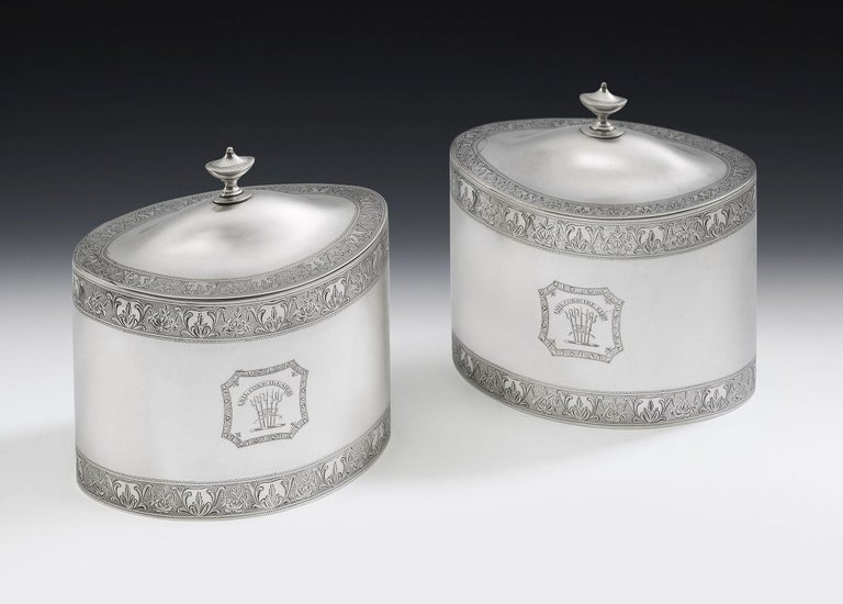 The Faulkbourne hall case tea caddies. These important and very unusual pair of George III Tea Caddies were made in London in 1793 by William Frisbee and are contained within a contemporary velvet and silk lined satinwood case, the hinges and handle