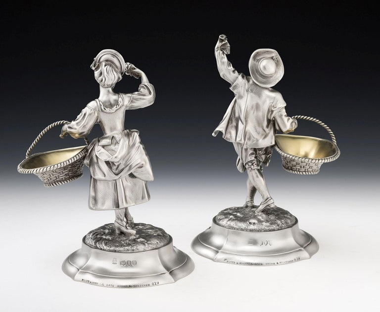 These important figural cast Pedlar Salt Cellars were made in London in 1892 by Alfred Benson & Henry Hugh Webb and retailed Hunt & Roskell. As you will see from the images the Salt Cellars are modelled as a male and female pedlar in period Georgian