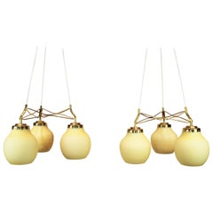 Pair of Ceiling Pendants of Brass and Light Yellow Shades by Vilhelm Lauritzen