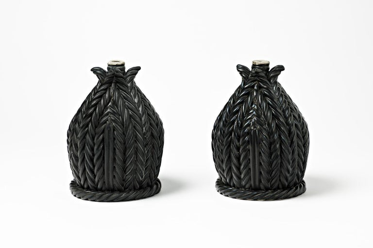 A pair of ceramic table lamps with black glaze decoration. Signed under the base. Perfect original conditions. circa 1960-1970. Sold without electrical system.