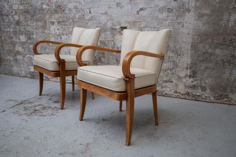 Art Deco A Pair of Cherrywood Armchairs in the Manner of Jean Pascaud, circa 1940 For Sale