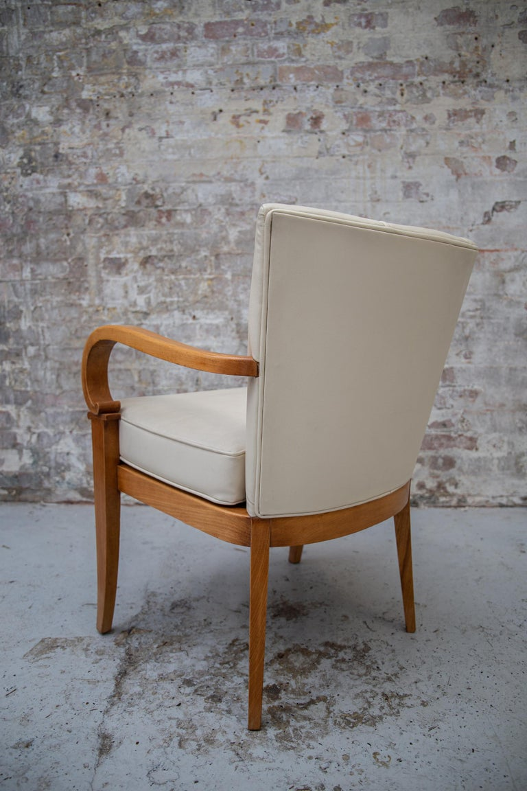 Mid-20th Century A Pair of Cherrywood Armchairs in the Manner of Jean Pascaud, circa 1940 For Sale