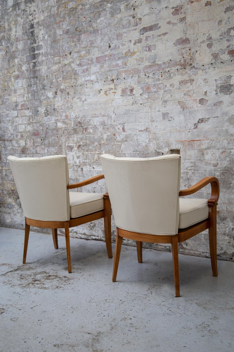 A Pair of Cherrywood Armchairs in the Manner of Jean Pascaud, circa 1940 For Sale 1