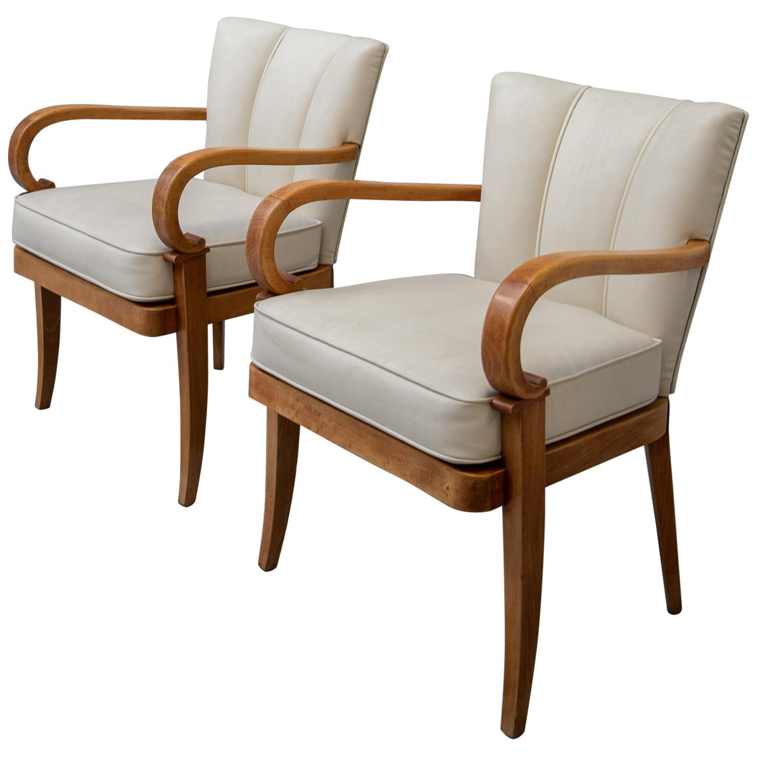 A Pair of Cherrywood Armchairs in the Manner of Jean Pascaud, circa 1940