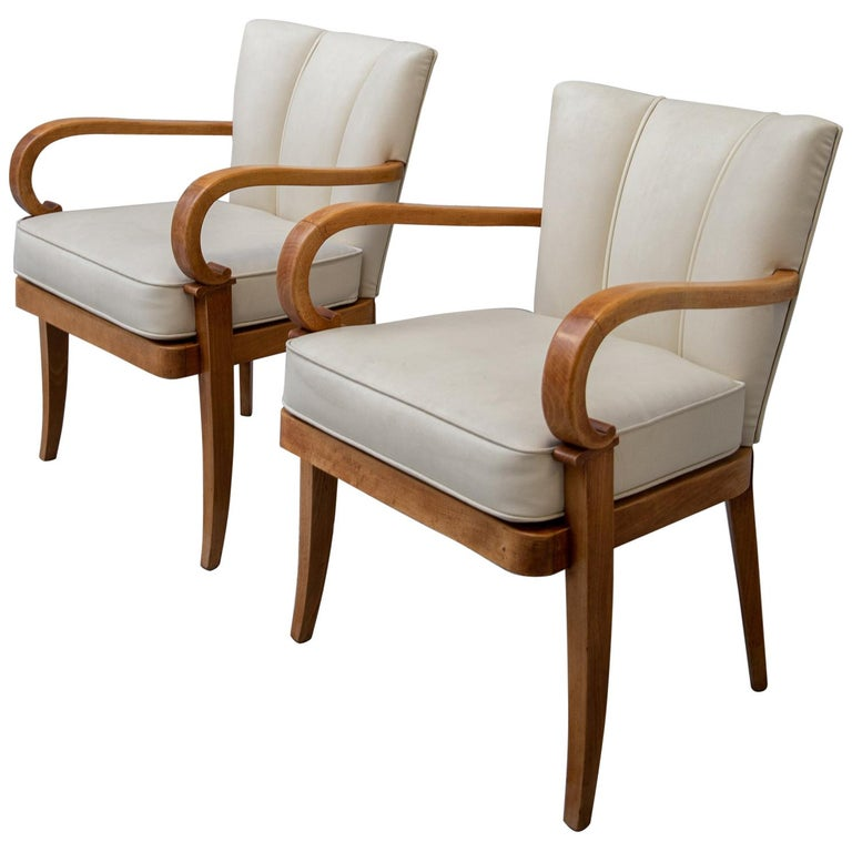 A Pair of Cherrywood Armchairs in the Manner of Jean Pascaud, circa 1940 For Sale