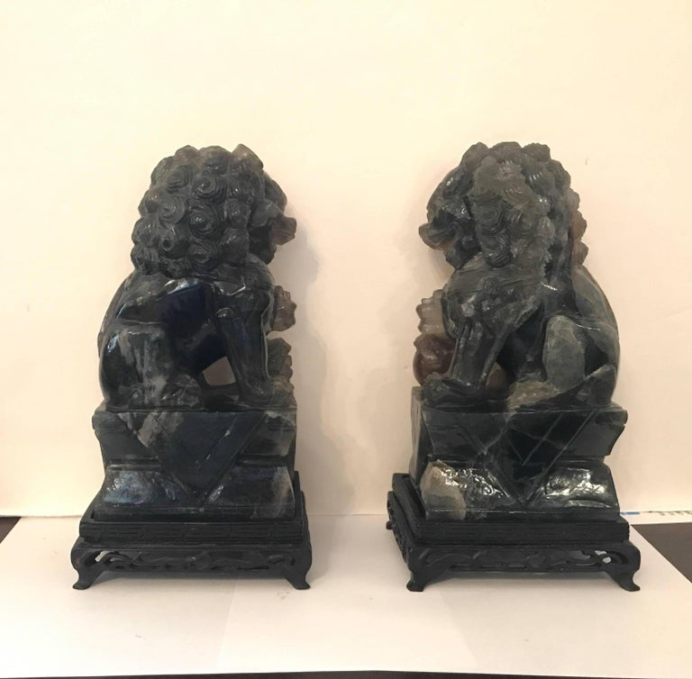 Early 20th Century Pair of Chinese Carved Green Quartz Foo Dogs For Sale