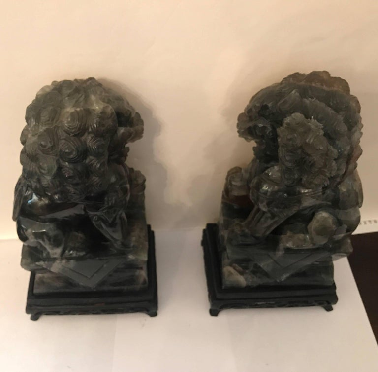 Pair of Chinese Carved Green Quartz Foo Dogs For Sale 1