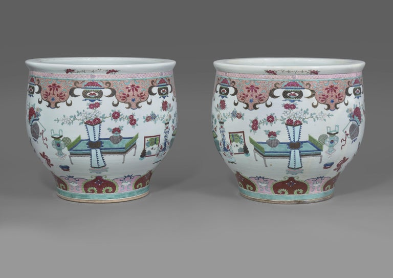 A pair of Chinese-style porcelain fish bowls attributed to Samson & Cie.  French, circa 1890.   Painted with the 'Hundred Antiques' pattern with prunus, peonies, chrysanthamums, pine and other flowering branches between lappet-shaped