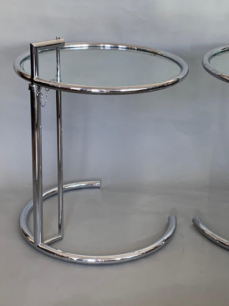 A pair of iconic tables designed by Eileen Gray, circa 1920s. The tops adjust from approx. 22