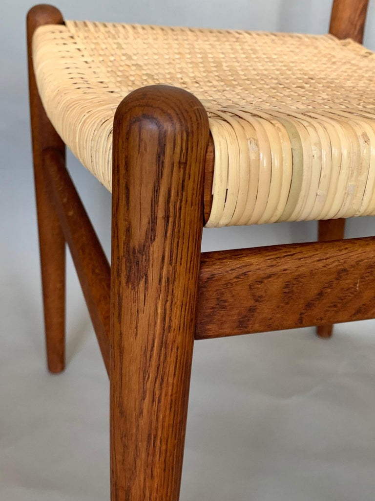 A pair of signed Hans Wegner side or dining chairs by C.M.Madsens, Denmark ca' 1950s. Oak with newly recaned seats. Comfortable and sculptural these chairs look beautiful from any angle.